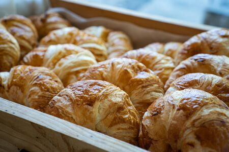 A tray with fresh croissant bread puff pastry.