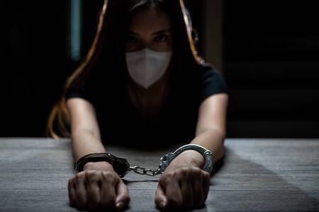 Handcuffed on a prisoner, Woman prisoners were handcuff in the dark prison.