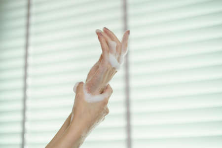Washing hands with soap. For killing germs, bacteria and virus.