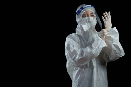 Doctor wearing ppe suit, face mask, surgical glove and face shield , Corona virus, Covid-19 virus outbreak concept black background