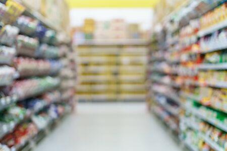 Supermarket blurred backgroundinstant noodles on shelves at grocery. Banco de Imagens