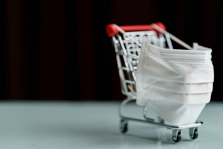 Shopping cart with protective face mask corona virus or Covid-19 protection.