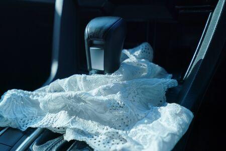 sex in car concept : Woman take off panty in a car. Archivio Fotografico