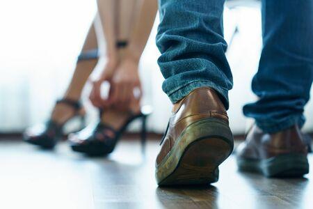 Body part : Couple feel romantic . Woman take off high heels shoes in bedroom. Sex concept. Standard-Bild