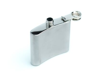 Stainless hip flask isolated on a white background