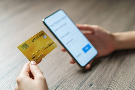 Mobile payments. hands using smartphone and credit card for online shopping. Фото со стока