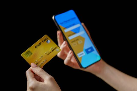 Online payment woman makes an online shopping by credit card payment on mobile smart phone.