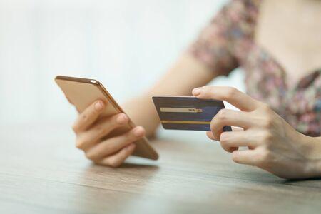 Online shopping concept : woman hands holding cradit card and using credit card online shopping. Stok Fotoğraf