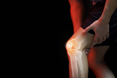 Medical concept, man suffering  with knee painful - skeleton x-ray,