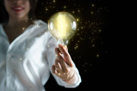 Woman hand holding light bulb. idea concept with inspiration.