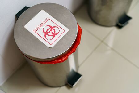 Close up bin for hazardous waste in hospital.