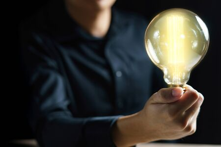 Man hand holding light bulb. idea concept with inspiration.