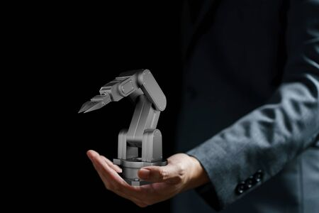 Business hand holding a robot arm, intelligence and machine concept. 3d