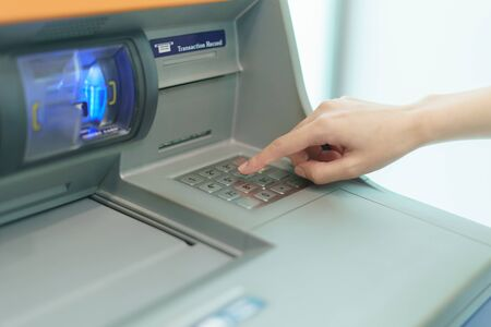 Woman finger pressing a button of Automated Teller Machine( ATM ) Stockfoto