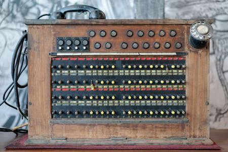Historical, telecommunications system. Old vintage telephone switchboard. Standard-Bild