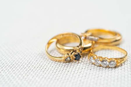 Group of diamond ring on white sack background.