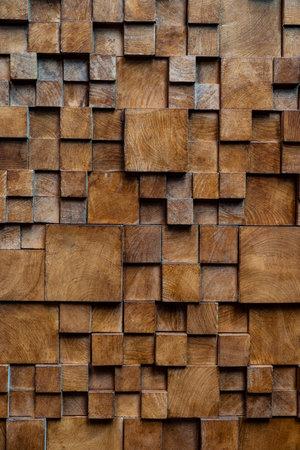 Brown wooden brick wall background, wood textured.