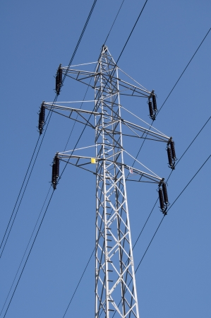 Electric power lines on a blue sky background  photo