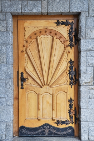 stone carvings: Old large wooden door