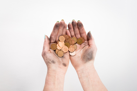 Where is muck there is money, two dirty hands holding coins isolated at the white background Banque d'images