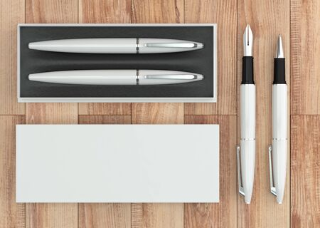 3d illustration render of a writing set. Ball pen and ink pen in a box on a wooden background. Top view.