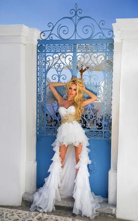fleeing: The beautiful bride in a wedding dress on Santorini in Greece