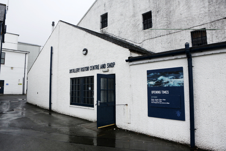 distillers: Carbost, Scotland - September 05, 2016: Talisker distillery is an Island single malt Scotch whisky distillery based in Carbost, Scotland  the only distillery on the Isle of Skye. The distillery is operated by United Distillers and Vintners for Diageo, and