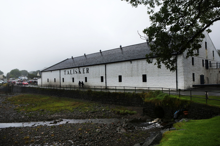 distillers: CARBOST, SCOTLAND - SEPTEMBER 05, 2016: Talisker distillery is an Island single malt Scotch whisky distillery based in Carbost, Scotland the only distillery on the Isle of Skye. The distillery is operated by United Distillers and Vintners for Diageo, and  Editorial
