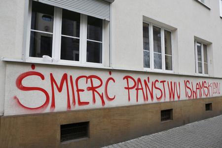 seeker: KRAKOW, POLAND, NOVEMBER 26, 2015, Graffiti anti Islam and ISIS at Krakow Editorial