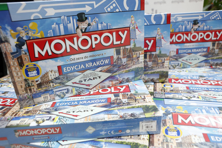 monopolio: KRAKOW, POLAND - NOVEMBER 07, 2015: First run Monopoly Edition Cracow Krakow at shopping center Bonarka City Center Editorial