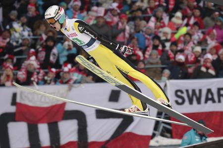sui: ZAKOPANE, POLAND - JANUARY 23, 2016: FIS Ski Jumping World Cup in Zakopane op Gregor Deschwanden SUI Editorial