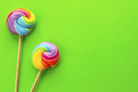 rainbow lollipop on color background