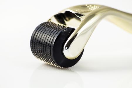 hair roller: Dermaroller for medical micro needling therapy. Tool also known as: Derma roller, mesoroller, meso-roller, mesopen.