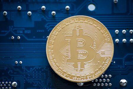 Bitcoin symbol coin on computer part