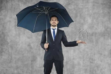 Businessman holding umbrella  photo