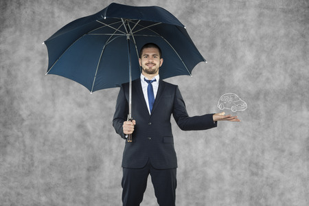 Businessman holding umbrella  photo