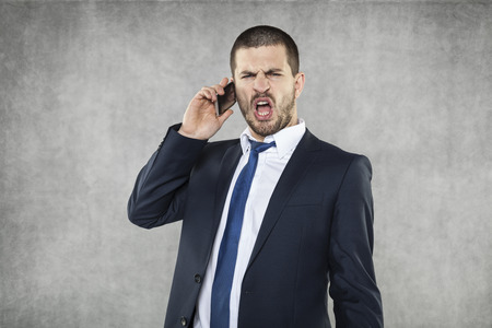 voicemail: angry businessman Stock Photo