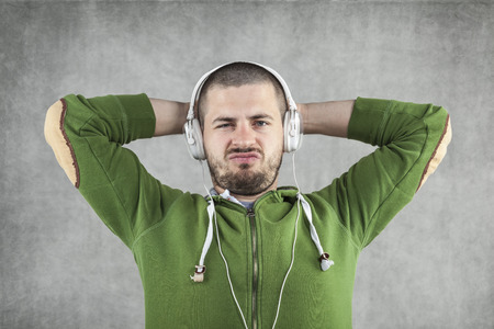 young boy relaxes by listening to music photo