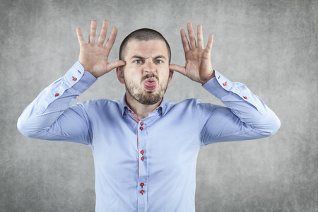 funny businessman playing on the nerves of the boss  Stock Photo