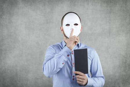 corruptible: businessman wearing a mask