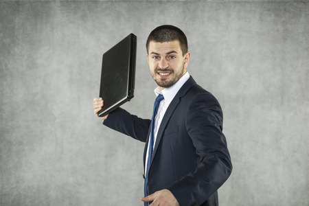 recipient: angry businessman ready to destroy a laptop Stock Photo