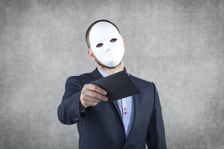 bribes: Businessman wearing a mask