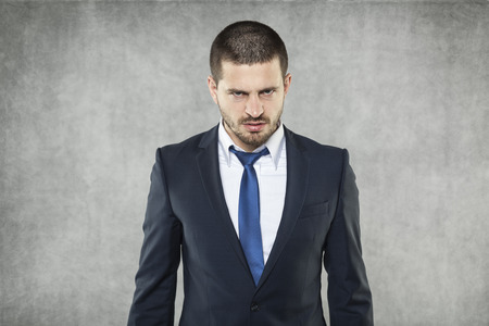 layoffs: Angry Face Stock Photo