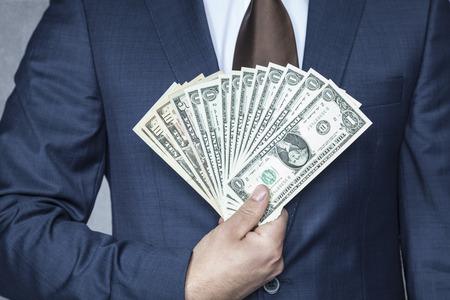 fortunately: man hand holding dollars Stock Photo