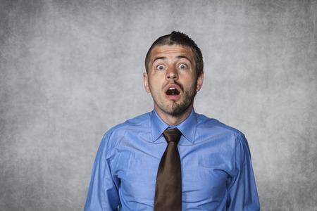 surprised businessman looking in disbelief photo