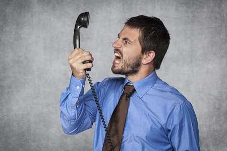 screaming face: I release you by the phone Stock Photo