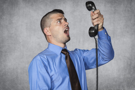 voicemail: angry businessman screaming during a telephone conversation Stock Photo