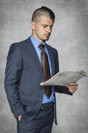 nonsense: Portrait of a businessman who reads the newspaper Stock Photo