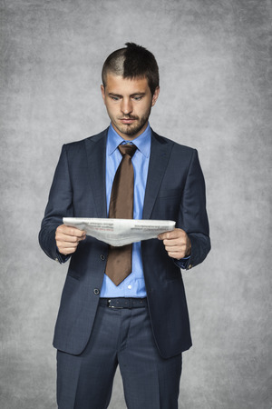 nonsense: surprised businessman reading a newspaper article Stock Photo