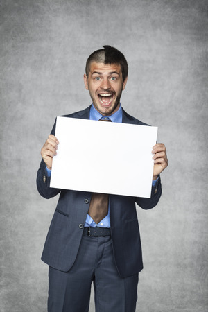 happy businessman holding a sheet of paper